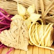 Decorative straw for hand made, flower and heart of straw, on wooden background — 图库照片