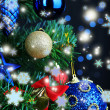 Toys on Christmas tree on  Christmas lights background — Stockfoto