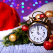 Composition with retro alarm clock and Christmas decoration on bright background — Стоковая фотография