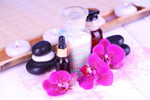 Beautiful spa setting with orchid on white wooden table close-up — Stock Photo