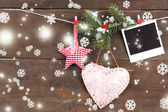Decorative heart, star and empty photo paper on rope, on wooden background — Стоковое фото