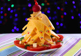 Christmas tree from cheese on table on dark background — Stok fotoğraf