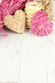 Decorative straw for hand made and hearts of straw, on wooden background — Stock Photo