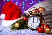Composition with retro alarm clock and Christmas decoration on bright background — Foto Stock