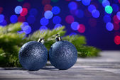 Christmas decorations on wooden table, on bright background — Foto Stock