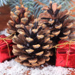Christmas decoration with pine cones on wooden background — Foto Stock #36685999