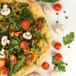 Tasty vegetarian pizza and vegetables on wooden table — Stock Photo