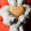 Female hands in mittens with heart, close-up — Stockfoto