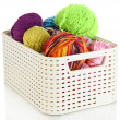 Plastic basket with yarn for knitting isolated on white — Stock Photo