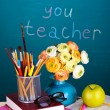 School supplies and flowers on blackboard background with inscription Thank you teacher — Stockfoto