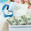 Dollar bills in envelope as gift at wedding on wooden table close-up — Stock Photo #36687661