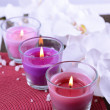 Composition with beautiful colorful candles, sea salt and orchid flowers, on color background — Stock Photo