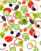 Falling fresh vegetables on white background — Stockfoto