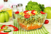 Tasty salad with fresh vegetables on wooden table — Stock Photo