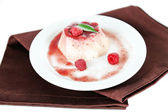 Panna Cotta with raspberry sauce, isolated on white — Stock Photo