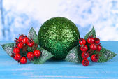 Composition of Christmas decorations on table on light background — Foto de Stock