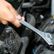 Hand with wrench. Auto mechanic in car repair — Foto de Stock