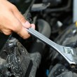Hand with wrench. Auto mechanic in car repair — Stockfoto