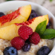 Oatmeal in cup with berries on napkins  — Stock Photo