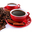 Red cups of strong coffee and coffee beans close up — Stock Photo