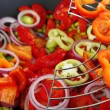 Stock Photo: Vegetables in wok close-up background