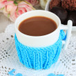 Cup with knitted thing on it close up — Stock Photo