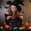 Halloween witch on dark background — Stock Photo #36697809