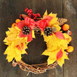 Beautiful Thanksgiving wreath, on wooden background — Stockfoto