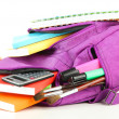 Purple backpack with school supplies isolated on white — Stock Photo #36698155