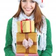 Beautiful smiling girl in New Year hat with gifts isolated on white — Stock Photo #36698391