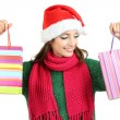 Beautiful smiling girl with gift bags isolated on white — Stock Photo