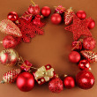 Beautiful Christmas decorations on brown background — Stockfoto