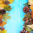 Frame from autumn leaves on wooden table close-up — Stock Photo