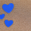 Blue hearts made of felt on golden background — 图库照片
