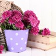 Bouquet of pink chrysanthemum in bucket on white wooden background — Foto Stock