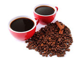 Red cups of strong coffee and coffee beans isolated on white — Stock Photo