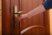 Locking up or unlocking door with key in hand — Stock Photo