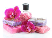 Sea salt, soap and orchid isolated on white — Stock Photo