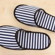 Striped slippers on wooden background — Stock Photo