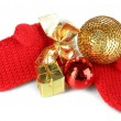 Red winter mittens with Christmas toys isolated on whited — Stock Photo