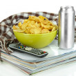 Chips in bowl and TV remote isolated on white — Stock Photo
