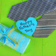 Happy Fathers Day tag with gift boxes and tie, on wooden background — Stock Photo