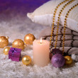 Composition with plaids, candles and Christmas decorations, on white carpet on bright background — Stock Photo