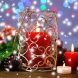 Candles and Christmas decoration on bright background — Stok fotoğraf