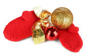 Red winter mittens with Christmas toys isolated on whited — Foto Stock