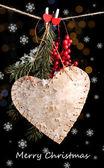 Dekorativt hjärta på rep mot glänsande bakgrund — Stockfoto