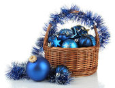 Christmas decorations in basket isolated on white — Stock Photo