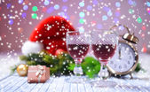 Wine glasses and Christmas decoration on bright background — Stockfoto