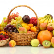 Assortment of exotic fruits and berries in baskets isolated on white — Stock Photo #36863711