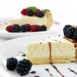 Slices of cheesecakes on plate, close-up — Stock Photo